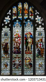 Salisbury, England - Sep 1, 2018: St Thomas and St Edmunds Church - Memorial Window in the South Aisle, circa 1920, Artist was G. F. Hutchinson and the Glaziers, James Powell and Sons of London