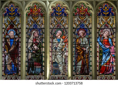 Salisbury, England - Sep 1, 2018: St Thomas and St Edmunds Church - The East Chancel Window Lower Lights, Victorian Glass inserted in 1856