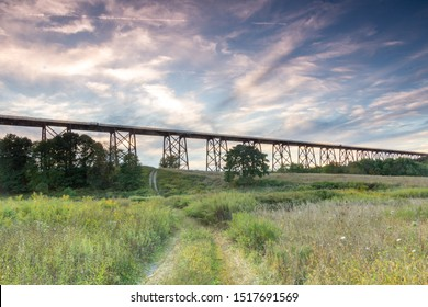 Salisbury Mills, NY / United States - Sept. 29, 2019:  Sunset view of the Moodna Viaduct, an iron railroad trestle spanning Moodna Creek and its valley .