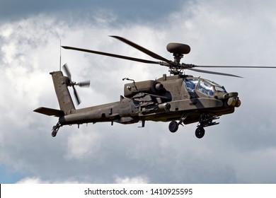 Salisbury Plain, n/ UK -July 1 2011:A British Army Air Corps AugustaWestland WAH-64D Apache AH.1 helicopter flies over the Salisbury Plain Military Training Area in Wiltshire, United Kingdom