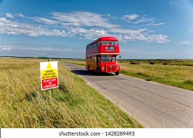 Salisbury Plain, Wiltshire / UK - August 22 2015: Former London Transport Routemaster bus, RM1978- ALD 978B, makes its way across the Salisbury Plain Military Training Area from Imber 'Ghost' village