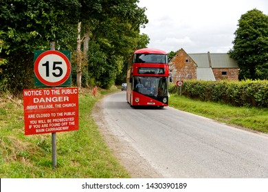 Salisbury Plain, Wiltshire /UK - August 20 2016: A transport for London( TFL) Boris bus passes through Imber village on the Salisbury Plain Training Area in Wiltshire at the 2016 Imberbus running day