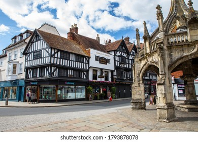 Salisbury, UK - August 2nd 2020: A beautful Tudor era timber-framed building and the Poultry Cross in the city of Salisbury in the UK.