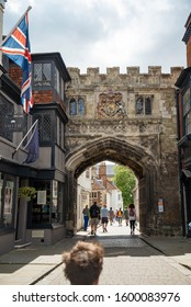 SALISBURY, UK - JULY 19, 2015: The medieval North Gate, known as the High Street Gate, to the Cathedral Close. Tourists walk along High Street, leading to Salisbury Cathedral.