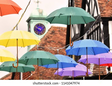 Salisbury, UK. July 21 2018. A floating canopy of colourful umbrellas has been installed in Salisbury city centre to inspire hope and encourage visitors to the city following the novichok incidents