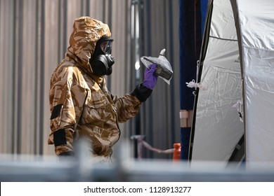 Salisbury, UK - July 6, 2018: An army officer searches a city centre hostel as investigations continue after local residents Charlie Rowley and Dawn Sturgess fall ill with nerve agent poisoning.