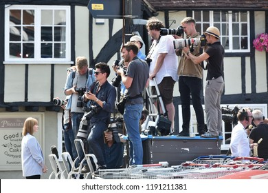 Salisbury, UK - July 6, 2018: Photojournalists stand on an exchange box, waste disposal container and shopping trolleys as police cordon of a hostel following the posioning of residents with novichok.