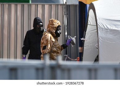 Salisbury, UK - July 6, 2018: An army officer hands over evidence during searches at a city centre hostel as investigations continue after resident Dawn Sturgess falls ill with nerve agent poisoning.