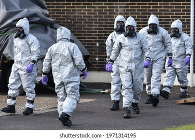 Salisbury, UK - March 8, 2018: Army and police in hazmat suits take part in an investigation and clean-up operation after the nerve agent poisoning of former Russian spy Sergei Skripal.