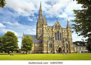 SALISBURY, UNITED KINGDOM -  August 03, 2015: Salisbury Cathedral and park on sunny day on August 03, 2015 in Salisbury, South England