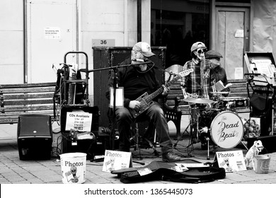 Salisbury, Wiltshire, England - April 07, 2019, monochrome rhythm and blues The Dead Beats street entertainers with mechanical drummer entertaining the shoppers