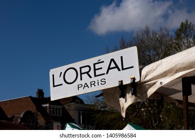 Salisbury, Wiltshire, England - April 14, 2019: Loreal Paris sign pegged onto market stall canopy, the worlds largest beauty and cosmetics group, company established in 1909