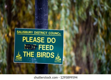 Salisbury, Wiltshire, England - December 18, 2018: defaced Salisbury district council do not feed the birds sign