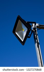 Salisbury, Wiltshire, England - February 25, 2019: Automatic PIR, passive infrared sensor, LED floodlight providing nighttime safety and security