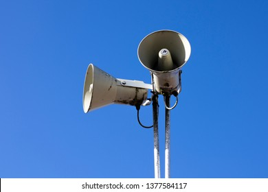 Salisbury, Wiltshire, England - February 25, 2019: PA public address system speakers fixed to timber telegraph pole