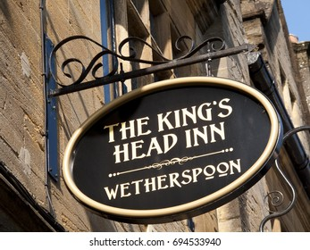 Salisbury, Wiltshire, England - July 25, 2017: JD Wetherspoon The Kings Head Inn public house and hotel sign above premises, the site has been an inn since the fifteenth century