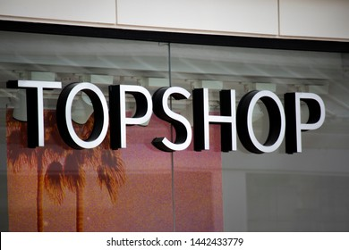 Salisbury, Wiltshire, England - June 28, 2019: Topshop ladies high street fashion store sign and window display, part of the Arcadia Group owned by Sir Philip Nigel Ross Green
