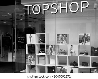 Salisbury, Wiltshire, England - May 5, 2017: Monochrome Topshop ladies high street fashion store sign and window display, part of the Arcadia Group owned by Sir Philip Nigel Ross Green