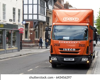 Salisbury, Wiltshire, England - May 5, 2017: TNT Express lorry parked in street making delivery or collection, company part of FedEx