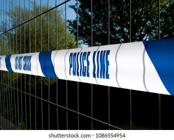 Salisbury, Wiltshire, England - May 7, 2018, Police line do not cross tape on fencing closing off contaminated area following the Novichok nerve agent attack on Sergei Skripal and his daughter Yulia