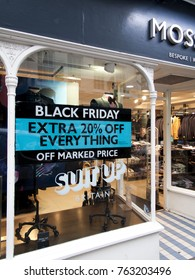 Salisbury, Wiltshire, England - November 22, 2017: Moss Bros Black Friday signs in high street stores advertising price discounts