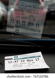 Salisbury, Wiltshire, England - November 22, 2017: Wiltshire Council pay and display parking ticket on vehicle dashboard showing time, date and fee paid