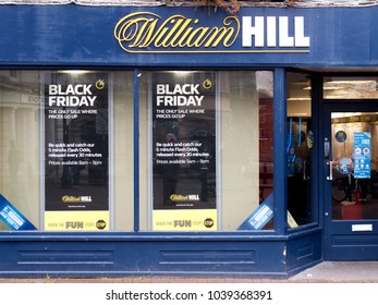 Salisbury, Wiltshire, England - November 24, 2017: William Hill bookmakers sign, company founded by William Hill in 1934 at a time when gambling was illegal in Britain
