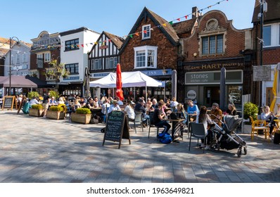 Salisbury, Wiltshire, England, UK. 2021. Pubs and restuarants with customers on Market Square as Covid restriction are eased for outside dining.