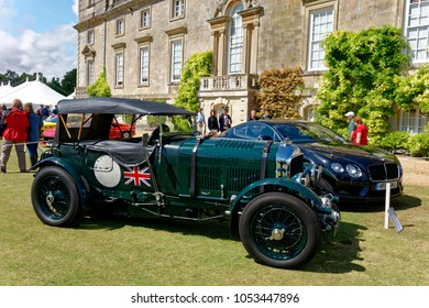 Salisbury, Wiltshire, UK - August 20, 2014: A 1930 Bentley 4.5 Litre Sports car and a Bentley Continental GT V8 at a car show