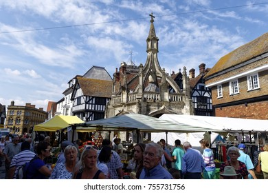 Salisbury, Wiltshire, UK- August 27, 2013:Shoppers at an outdoor market in front of the 15th Century Poultry Cross in Butcher Row, Salisbury, Wiltshire, United Kingdom, 27th August 2013.