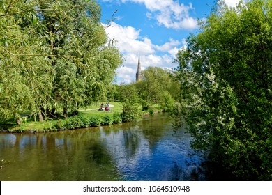 Salisbury, Wiltshire, UK - May 13, 2017: The cathedral as seen looking across the river Avon