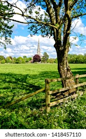 Salisbury, Wiltshire / UK - May 13 2017:       Salisbury Cathedral, Wiltshire, United Kingdom, as seen from the Harnham Water Meadows.