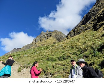 Salkantay, Trail, Cusco Province, Peru - May 8th, 2016: A young group of international hikers, led by their local Inca guide, navigate the Andes mountains on the Salkantay Trail towards Machu Picchu.