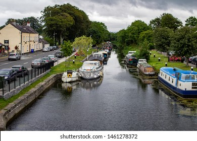 Sallins, Kildare, Ireland, 25th July 2019. The 13th lock of the Grand Canal, in Sallins, County Kildare, with canal houseboats berthed on either side.