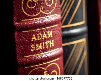SALMON ARM, CANADA � DECEMBER 27, 2013: Close up of leather bound book spine showing author's name of Adam Smith a Scottish philosopher and economist