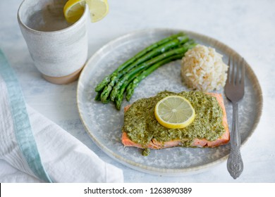 Salmon and asparagus on a gray plate