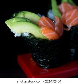 Salmon and avocado hand roll