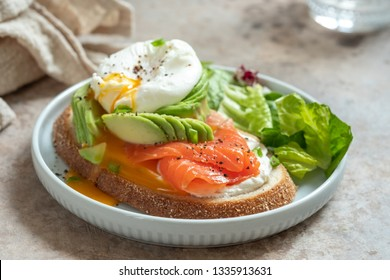 Salmon, avocado and poached egg sandwich, healthy eating
