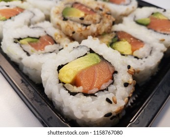 salmon and avocado and rice sushi rolls