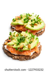 Salmon  and avocado rye bread sandwich isolated on white