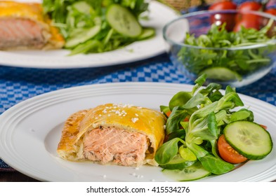 Salmon baked in puff pastry with summer salad