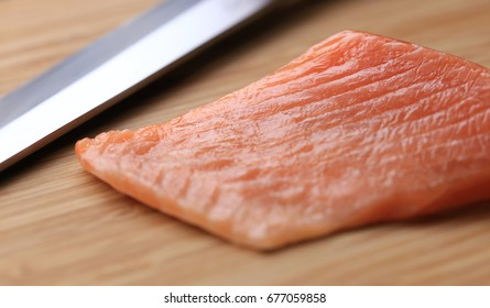 salmon belly and knife