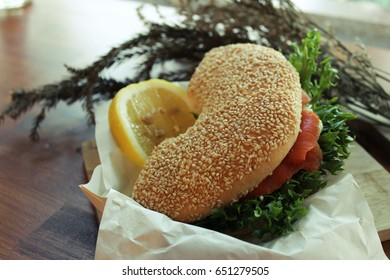 Salmon burger with fresh vegetables. Healthy food. Cafeteria.
