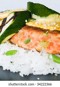 Salmon Cakes on rice with grilled summer squash and mustard sauce