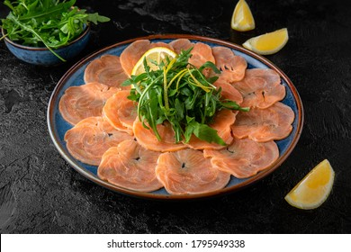 Salmon carpaccio with parmesan, balsamic sauce and arugula