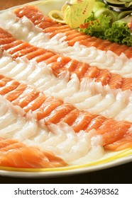 SALMON AND COD - A tray of raw salmon and cod