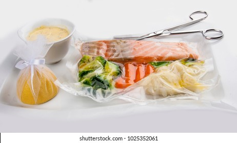 Salmon cooked sous vide with vegetables on a white background