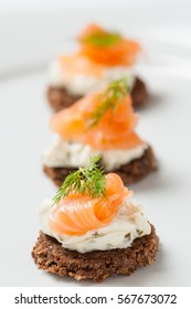 salmon with cream cheese on a slice of rye bread