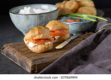 Salmon and creamcheese puffs .  holiday snack catering. Profiteroles or canape.