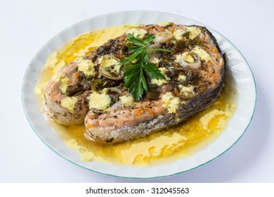 Salmon cutlet with sauce - white background